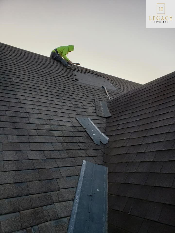 Shingle roof repair underway