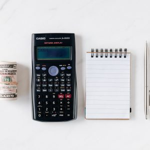 Home Improvement Financing with pen, paper, and a calculator