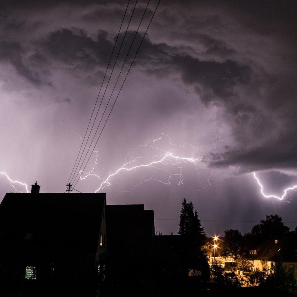 Dark clouds and lightning above a neighborhood
