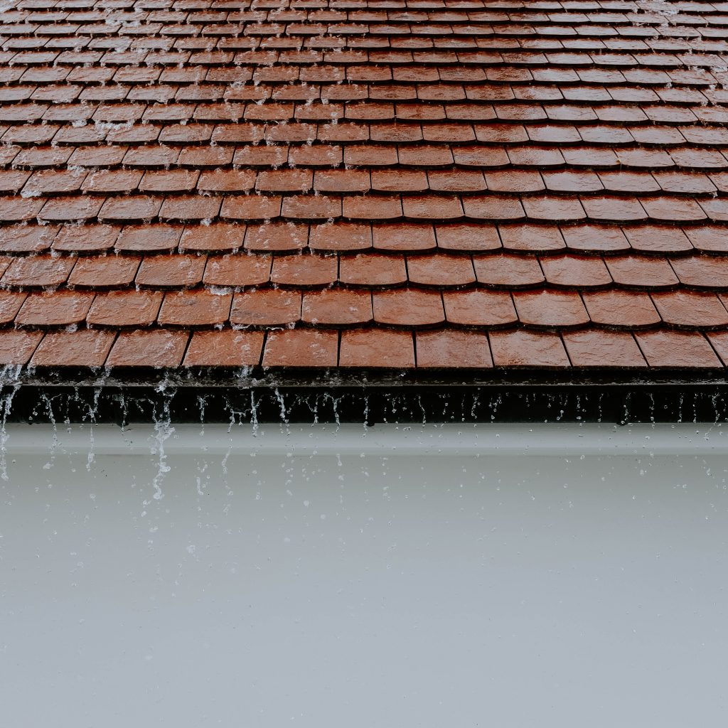 Roof with overflowing rain gutters